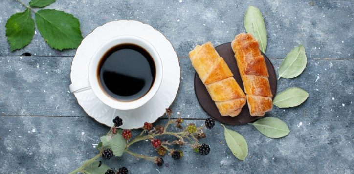 top-view-cup-coffee-along-with-sweet-delicious-bangles-berries-grey-wooden-sweet-bake-pastry-cake-sugar-2